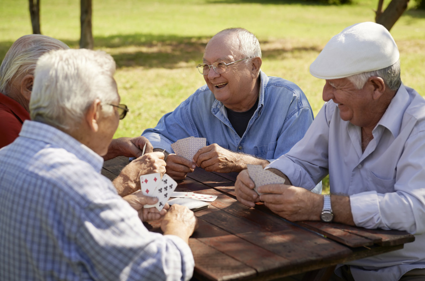 senior men playing card game